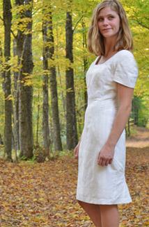 Mariposa, knee length wedding dress with sleeves, $1,200