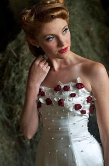 Linda is a Sustainable Lace Up Wedding Dress, $3,500